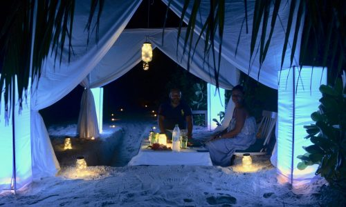 Have a romantic dinner on the beach in the Maldives