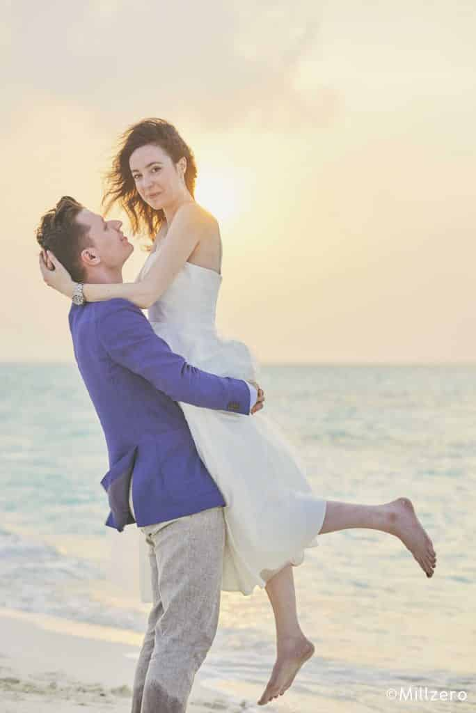 Couple after wedding ceremony on the beach during sunset