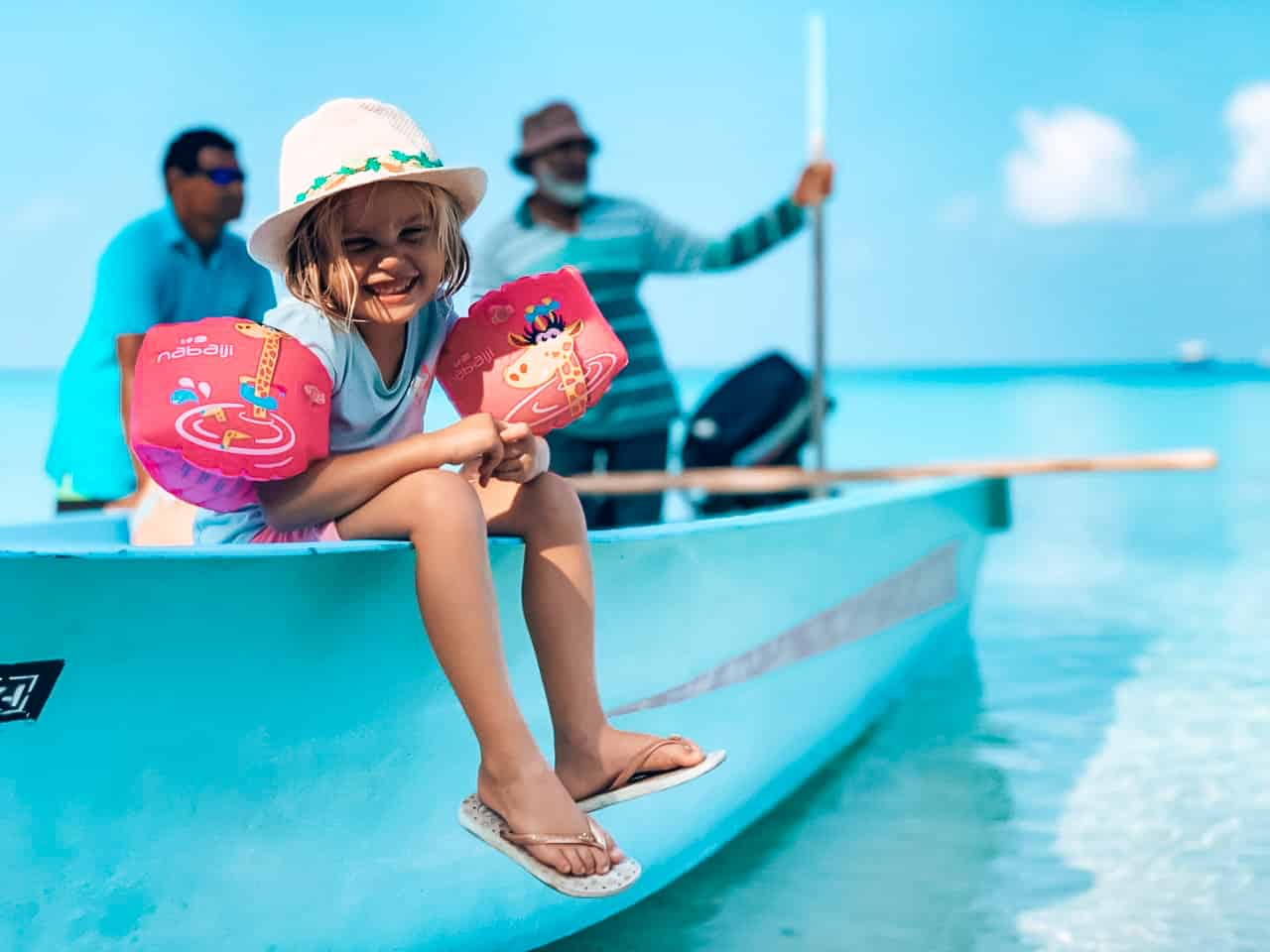 Family deal - Girl on a local dinghy ready for an excursion