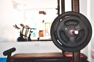 Weights rack in the gym of Bliss Dhigurah. Treadmill and bike in the background