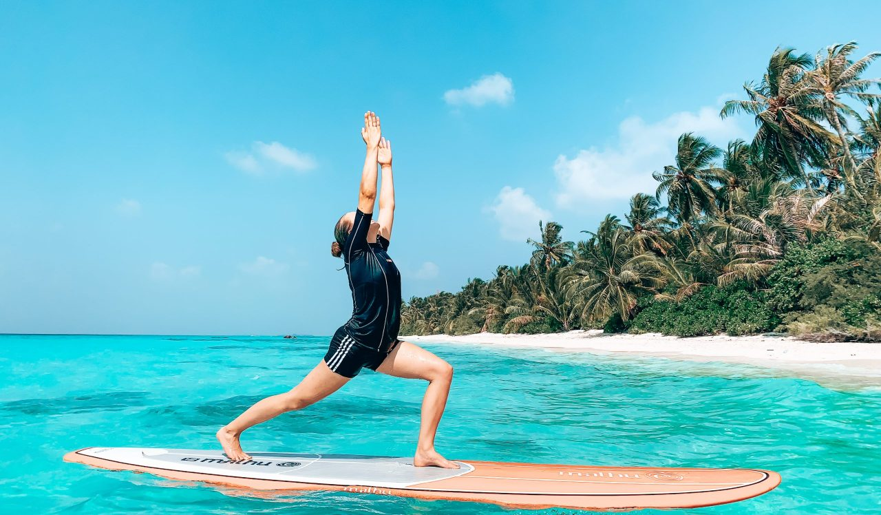 A woman on a Stand Up Paddle (SUP) board. One of the activities on Dhigurah