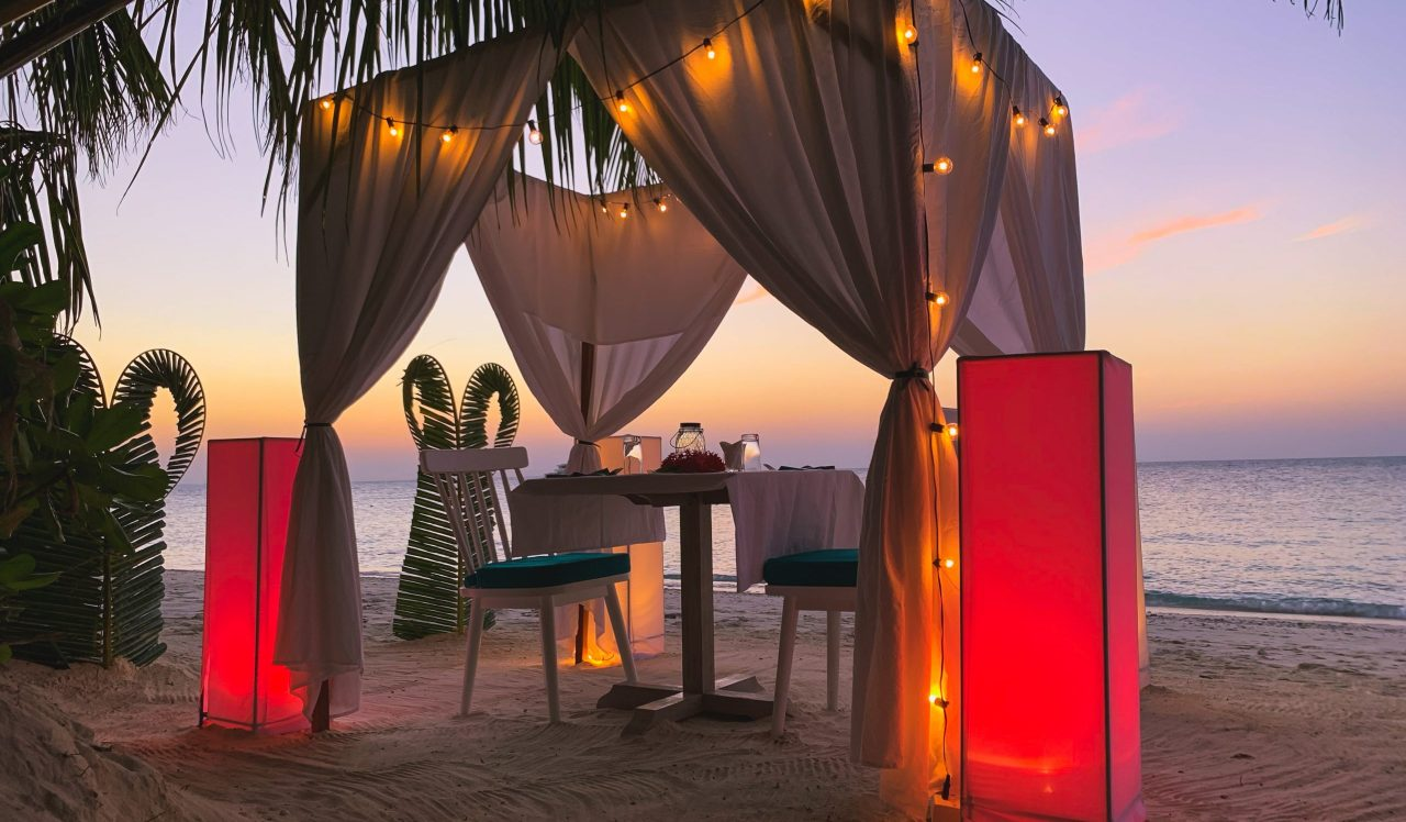 Private romantic beach dinner setup by Hermit's - Bliss Dhigurah's in-house restaurant.